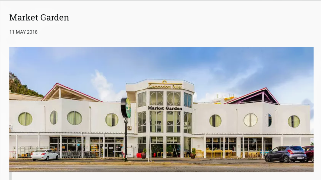 white building with round windows and parking lot