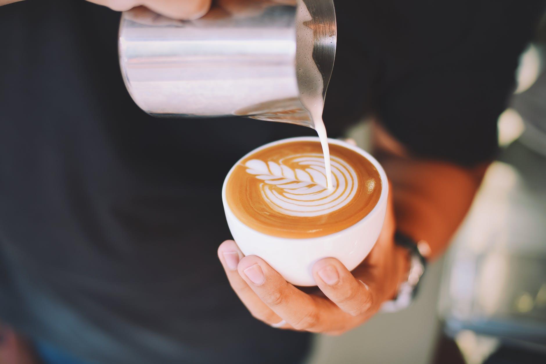 pouring a cappuccino